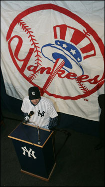 It's still jarring for Red Sox fans to see Johnny Damon backdropped by the Yankees logo.