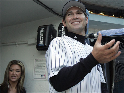 Johnny Damon and wife Michelle entered the dugout after a press conference introducing him to the