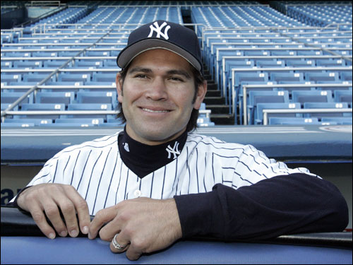 Johnny Damon posed for photographers from the dugout at Yankee Stadium on Friday.