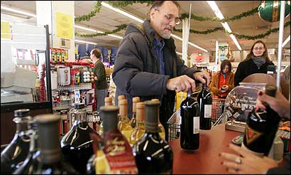 Michael Hass of Back Bat stocked up on wine at Blanchard's liquor store in Allston yesterday. 'The Monday law is so obscure,' he said. 'People don't even know it's on the books.'