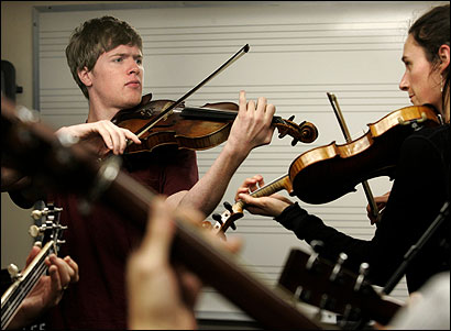 Clayton Mathews and Mariel Vandersteel played their fiddles during a bluegrass ensemble at the Berklee School of Music.