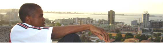 Yuri Domingos looks over skyline of Luanda, Angole