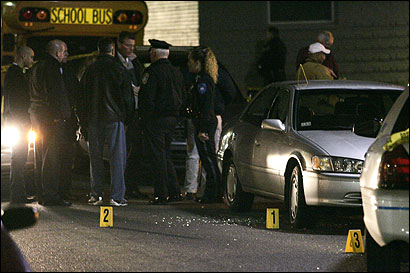 Police surveyed the scene of last night's multiple shooting in Roxbury. Markers identified the location of shell casings.