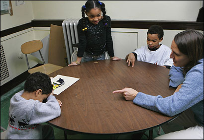 Shella Dennery, a counselor, talked to three of Carmen Davila's children — (from left) Nael, 5, Nayza, 8, and Nathaniel, 11 — at the Sarah Greenwood School in Dorchester.