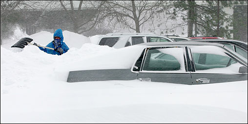 The Blizzard of 2005 delivered a staggering blow to much of Eastern Massachusetts Jan. 24, dropping more than 3 feet of snow in some places and whipping it into towering drifts with howling gusts that topped 80 miles per hour along the coast. At left, Jackei Ranta cleaned snow from her car on the Lynnway. <img src ='http://cache.boston.com/bonzai-fba/File-Based_Image_Resource/dingbat_arrow_icon.gif' alt='' title='' height='9' width='4' border='0' /> <a target='new' href ='http://www.boston.com/news/weather/articles/2005/01/24/winter_whopper_buries_region'>Story &nbsp; <img src='http://cache.boston.com/bonzai-fba/File-Based_Image_Resource/dingbat_arrow_icon.gif' alt='' title='' height='9' width='4' border='0' /> The Blizzard of 2005
