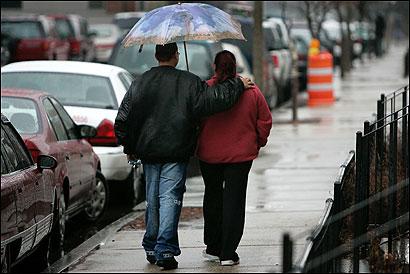 David Soto and his mother, Santa Moreta, walked past the scene of a shooting on Lenox Street in Roxbury.