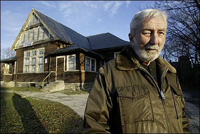 Charles Petitti, former commander, stood at American Legion Post 17 in Brighton. A developer has bought the building, and has aided the veterans.