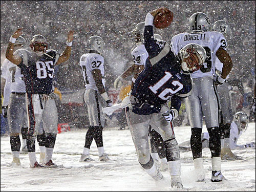 The tuck rule game Brady's first playoff start -- Jan. 19, 2002 -- was a memorable one. In the driving snow, Brady led the Patriots on a late rally (with a little help from the tuck rule) to get the Patriots past the Raiders, 16-13. He set single-game Patriots postseason passing records with 52 attempts, 32 completions, and 312 yards. In the second half alone, Brady completed 26 of 39 passes for 238 yards. The game is famous for a play in which Brady appeared to be passing and had the ball knocked loose when he was hit by the Raiders' Charles Woodson. The apparent fumble was overturned on replay, as officials said Brady was passing and it therefore was an incomplete pass. The ruling sustained a game-tying drive, and the Patriots won in overtime.