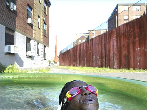girl splashing in green pool