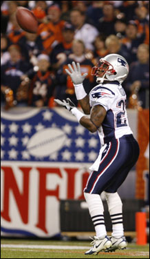 Ellis Hobbs of the New England Patriots pulled in the opening kickoff against the Denver Broncos at Invesco Field.