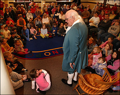 Bill Meikle, a Benjamin Franklin impersonator, talks about Franklin's life at a 300th birthday celebration for the Massachusetts native in the town named after the famous inventor and patriot.