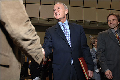 Attorney General Thomas F. Reilly greets supporters yesterday before a candidate's forum yesterday in Boston.