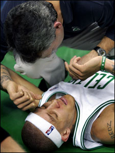 Celtics guard Delonte West was attended to by trainer Ed Lacerte after he was injured in the first half. He left the game, but returned in the second quarter.