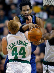 Minnesota's Michael Olowokandi gets hooked in the mouth by the Celtics Brian Scalabrine, as he battles two Boston frountcourt players who could possibly be his teammates soon,