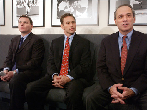 Jed Hoyer and Ben Cherington (right, with Lucchino) are promoted to co-GMs.