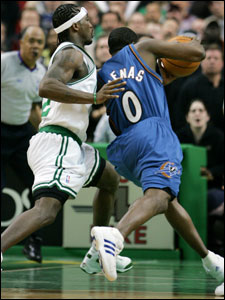 Washington's Gilbert Arenas draws a foul on Ricky Davis with just 1.7 seconds left in the game. Arenas would sink both free throws.