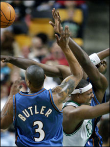 Paul Pierce seems to be caught in an arms race as he feels the squeeze of the Wizards' Caron Butler (left) and Brendan Haywood.