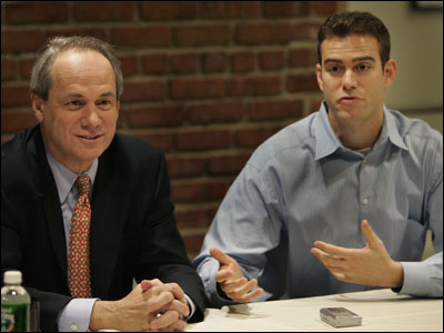 General manager Theo Epstein (right) said he and Larry Lucchino have been able to put aside their 'personal conflict'.