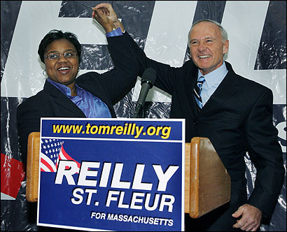 State Attorney General Thomas F. Reilly (right) and State Representative Marie St. Fleur in Dorchester yesterday.