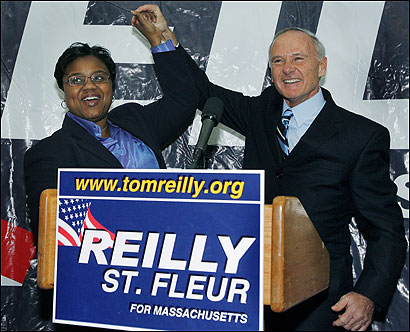 State Attorney General Thomas F. Reilly (right) and State Representative Marie St. Fleur in Dorchester on Tuesday.