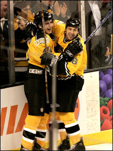 Patrice Bergeron (left) celebrates his second-period goal with Marco Sturm.