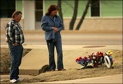 Tammy and Cindy Acuff visited a memorial site for slain Officer James Sell yesterday in Gassville, Ark.
