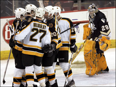 Brad Stuart is swarmed by his teammates after he beat Penguins goalie Marc-Andre Fleury (right) for his second goal.