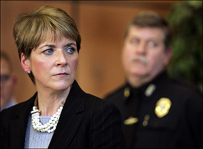 Middlesex District Attorney Martha Coakley listened to questions during a press conference this morning after she announced the arrest of Neil Entwistle for the murders of his wife and infant daughter in Hopkinton. Behind her is Hopkinton Police Chief Thomas Irvin.