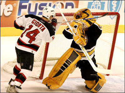 Brian Gionta scored two goals, but he lost this high-sticking battle with Tim Thomas.
