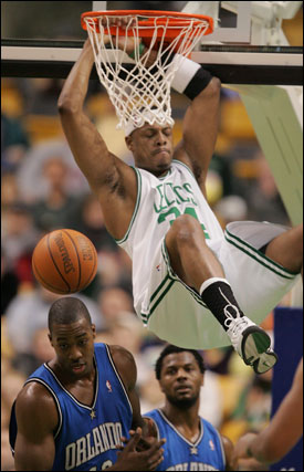 Paul Pierce gets 2 of his 31 points, dunking over Orlando's Dwight Howard.