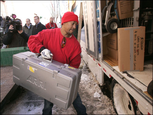 Donald Barboza loads Red Sox gear on the truck outside of Fenway Park.