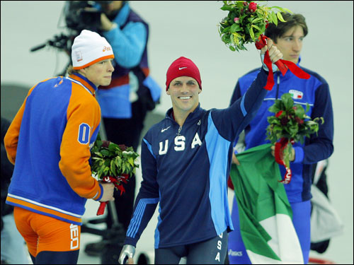 Chad Hedrick (center) of the United States took home the first gold medal of the Games for his country, winning the men's 5,000 meter speedskating event. He is flanked by silver medalist Sven Kramer (left) and bronze medalist Enrico Fabris.