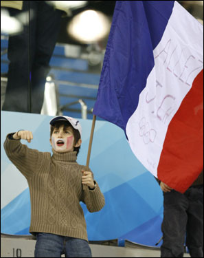 Marc-Awiele Mattei of France waved a French flag while cheering on his uncle Jean Charles Mattei, who competed in the 1,500 meter short track speed skating event.