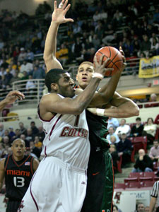 BC's Craig Smith (15 points) fights his way to the hoop in the first half of the Eagles' win over Miami at Conte Forum.