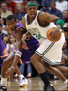 Paul Pierce, who finished with 20 points, has a tough time getting past the defense of the Suns' Leandro Barbosa.