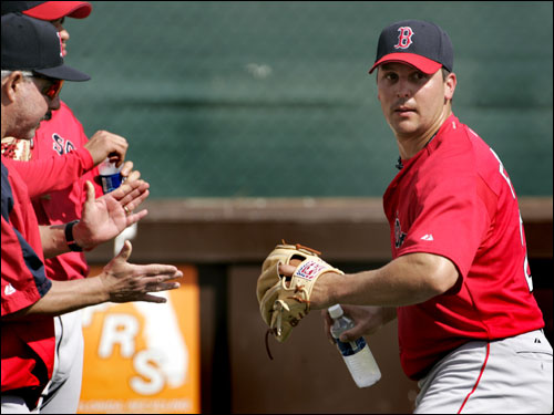 Red Sox pitcher Keith Foulke demonstrated his windup, using a water bottle, to bullpen coach/interim pitching coach Al Nipper.