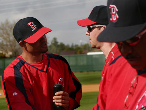 Sox newcomers Coco Crisp and Mark Loretta greeted each other for the first time on Wednesday.