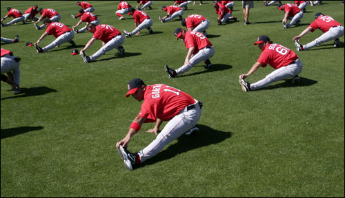 Shortstop Alex Gonzalez stretches with the team on the first day of full-squad workouts.