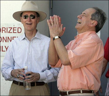 Red Sox owner John W. Henry, left, and president Larry Lucchino laugh before the team's workout on Thursday.