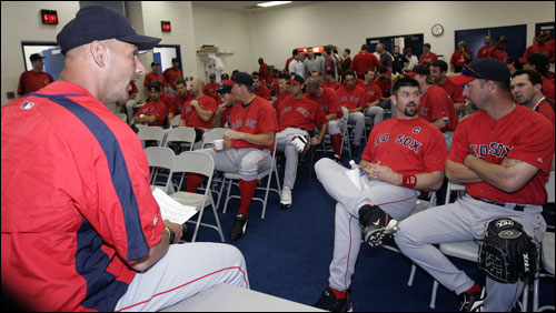 Red Sox manager Terry Francona (left) chats with team captain Jason Varitek (third from right) and pitcher Tim Wakefield (second from right) before a team meeting.