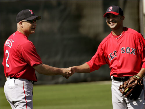 Gonzalez was greeted by bench coach Brad Mills.