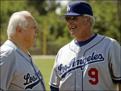 The former Red Sox manager (right) has been reunited with some of his old players in Los Angeles.