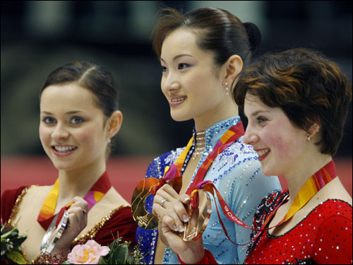 Shizuka Arakawa (center), of Japan, won the gold medal in the women's figure skating competition.