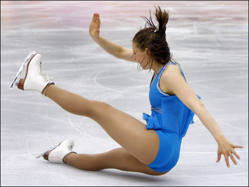 American Sarah Hughes fell in the long program but finished seventh in the figure skating competition.
