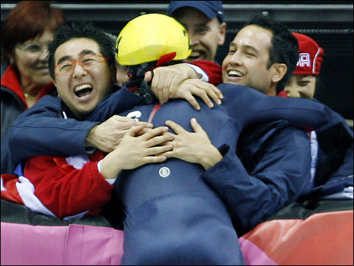 Ohno celebrated his gold medal with his teammates.