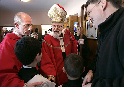 Archbishop Sean P. O'Malley and the Rev. Thomas Powers (left) greeted parishioners after Mass in St. Maria Goretti Parish yesterday in Lynnfield. It was O'Malley's first time mingling with parishioners since he was named cardinal.