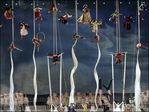 Performers are suspended high above the main stage at Stadio Olympico.