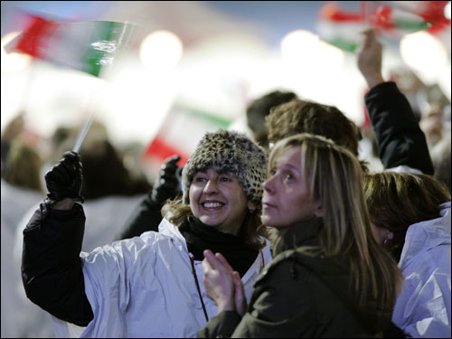 Italian fans cheer as a gold medal is awarded to Georgio di Centa for his first place finish in the men's 50 K free cross country nordic ski event.