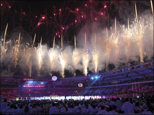Fireworks light up the night sky above the Olympians at Sunday night's extravagant closing ceremonies of the Turin Games.