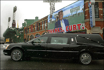 The funeral procession for former Boston Red Sox announcer Curt Gowdy passed outside Fenway Park before heading to Copley Square.